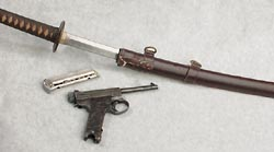 Pistol, magazine and a sword